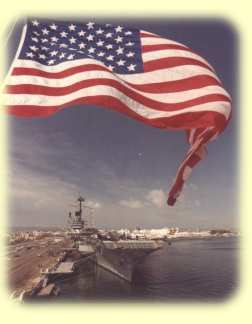 "This is a shot taken from the stern of the USS CONSTELLATION of RANGER decked out for Westpac 79. She was due to leave the next morning! This has become a ""classic"" photograph among RANGER shipmates-Photo submitted by Ed Weeden"