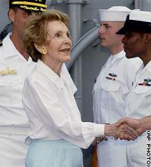 "Nancy Reagan shakes hands with crew members aboard the USS Ronald Reagan during preparations for the commissioning ceremony July 12, 2003 - ""Man the ship and bring her alive,"" said former first lady Nancy Reagan, who was on hand for the ceremony at Naval Station Norfolk."